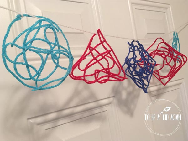 Make a garland and learn shapes with this colorful shape banner made from yarn and glue