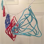 shape banner made from yarn and glue to practice geometric shapes for preschool craft