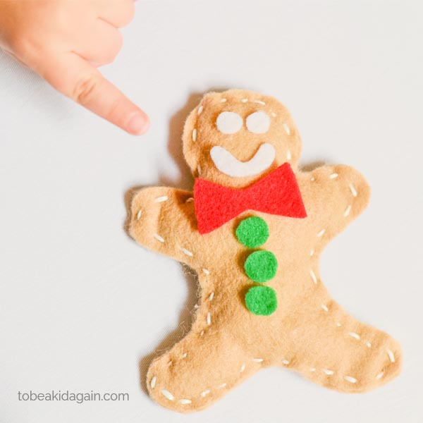 Today I am so excited to share a great first sewing project for kids. I'm mostly excited because I'm so proud of my son for learning how to sew! But I also think this kid-sewn gingerbread man is so very adorable, and a great Christmas decoration or toy.