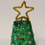 Light Up Christmas Tree Craft made from a foam cup and a tea light. Fun fine motor poke activity too.