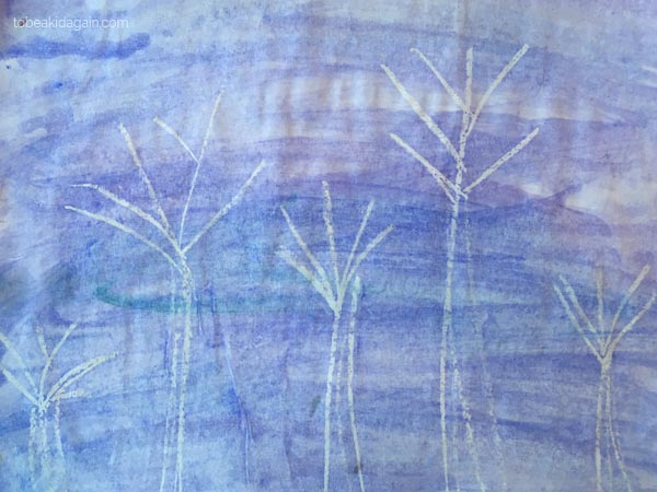 Simple water color resist techniques for kids. This one uses white crayon to create a design. Here we made winter trees
